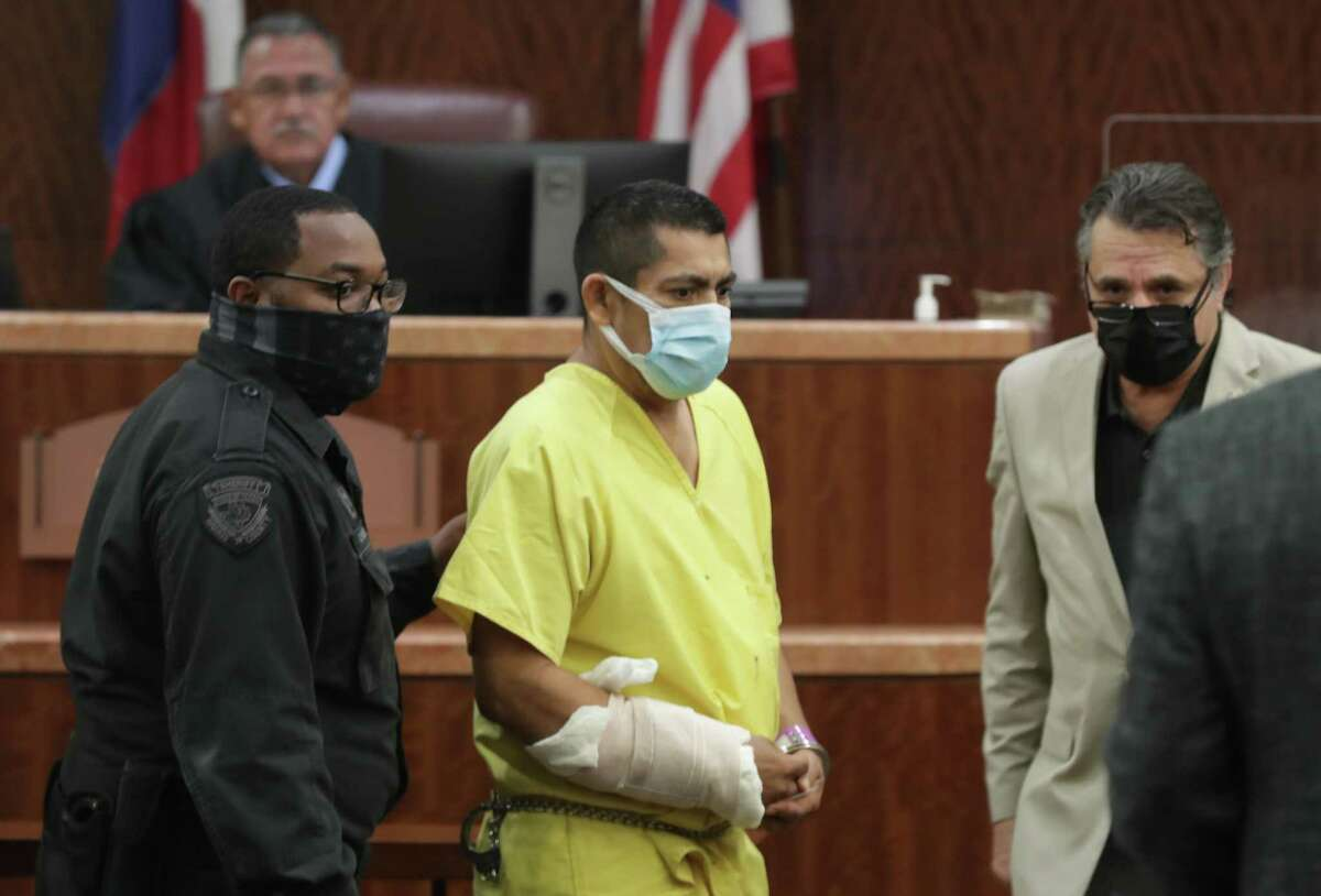 Elmer Manzano is escorted in to Judge Frank Aguilar, Court 228, while his attorney Mario Madrid (right) leads him to the defense table Wednesday, Oct. 28, 2020, in Houston. Manzano is accused of killing a Houston Police Sgt. Harold Preston.