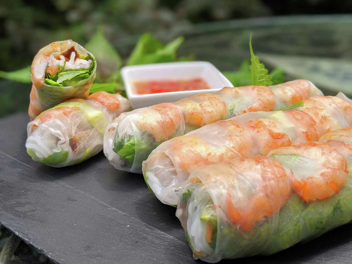 Vietnamese spring rolls are made with lettuce, herbs, cucumber and shrimp; served with a peanut hoisin sauce.