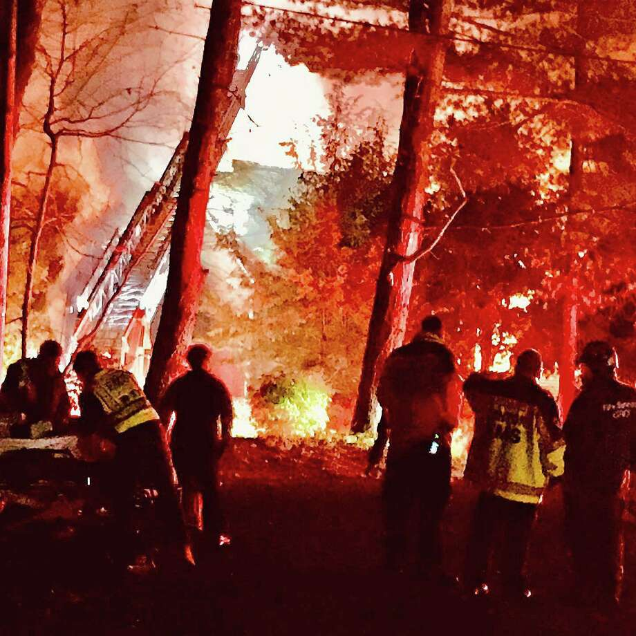 Two people were transported to Bridgeport Hospital's Burn Center after a fire broke out in their Canton house Tuesday night on Oct. 27, 2020. The intense fire, reported around 7 p.m., brought mutual aid from New Hartford, Simsbury and Burlington fire departmemts. Photo: Canton Volunteer Fire And EMS Department Photo