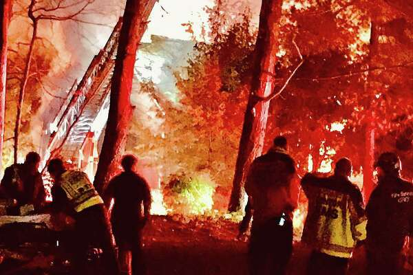 Two people were transported to Bridgeport Hospital's Burn Center after a fire broke out in their Canton house Tuesday night on Oct. 27, 2020. The intense fire, reported around 7 p.m., brought mutual aid from New Hartford, Simsbury and Burlington fire departmemts.