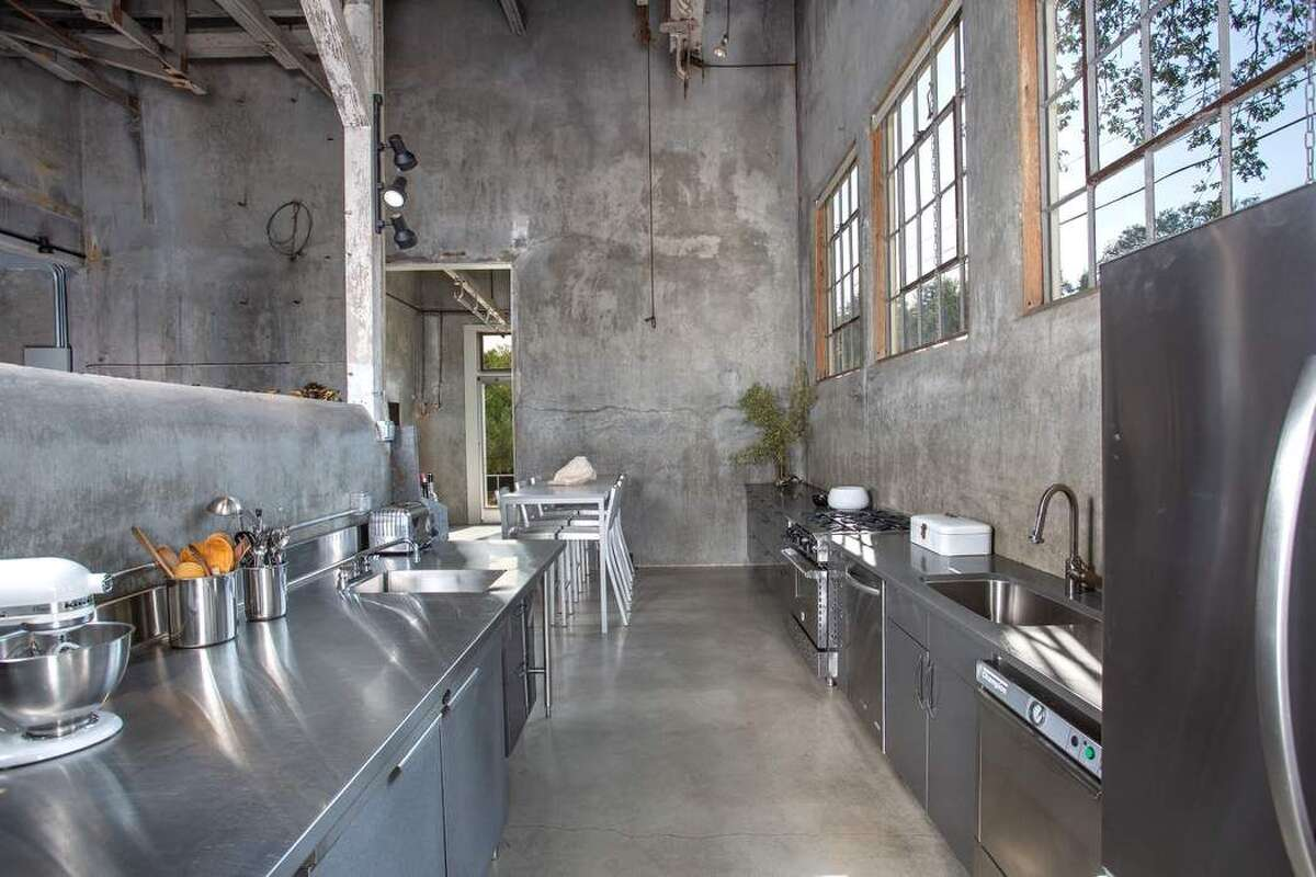 The largely stainless steel kitchen sticks with the industrial look of the rest of home. As the Lenzes often used the space to entertain and host events, it has two sinks, two dishwashers and a commercial range.
