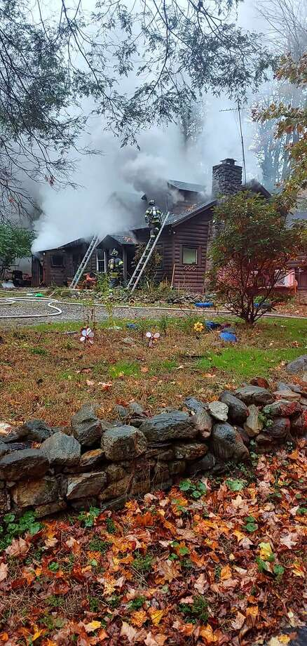 Firefighters at the scene of the house fire on Driftway Road in Danbury, Conn., the morning of Oct. 28, 2020. Photo: Contributed Photo / Justin Esposito