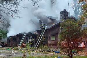 Firefighters at the scene of the house fire on Driftway Road in Danbury, Conn., the morning of Oct. 28, 2020.