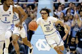 North Carolina guard Cole Anthony (2) dribbles against the Notre Dame during the first half of an NCAA college basketball game in Chapel Hill, N.C., Wednesday, Nov. 6, 2019. (AP Photo/Gerry Broome)