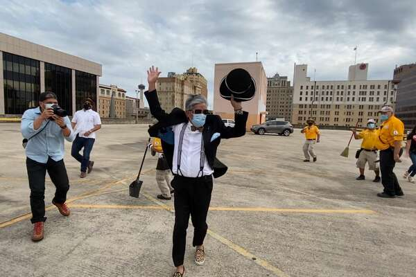 Michael Quintanilla in the front and District 1 Councilman Robert Trevino in the background dancing with downtown's essential working Centro Ambassadors.