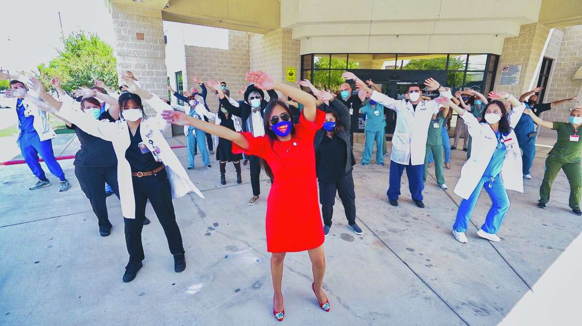 District 4 Councilwoman Adriana Adriana Rocha Garcia leads 67 frontliners and essential working health workers at Southwest General Hospital as she also dances with Michael Quintanilla in his 2020 dance video.