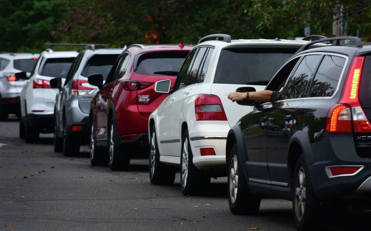 Cars cue up as Community Health Center staff administer Norwalk's free COVID-19 testing Saturday.