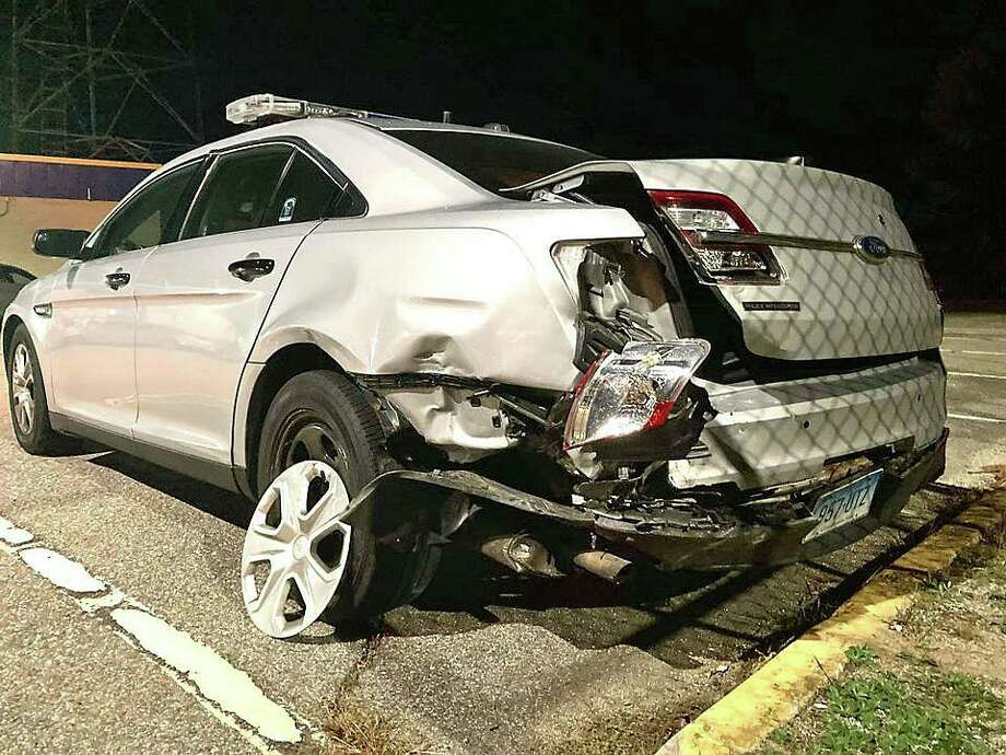 A Connecticut state trooper was injured Tuesday night on Oct. 27, 2020 after a DUI driver rear-ended his police cruiser on I-395, state police said. The trooper, Raymond Dussault, 27, is a recent graduate of the 129th Training Troop class. Dussault, whose hometown is Stonington, is assigned to Troop E in Montville. Jessica Lynn Clinton, 31, of Ledyard was charged with operating a motor vehicle under the influence of alcohol/drugs, failure to move over for an emergency vehicle, following too close resulting in an accident and operating with unsafe tires. Photo: State Police Photo