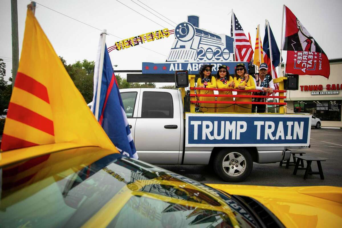 Donald Trump supporters line up at the Dakao Plaza off Bellaire Avenue for a Trump Train Rally on Sunday, Oct. 25, 2020. The train drove a loop around western Houston with flags, music and other symbols in support of Donald Trump.