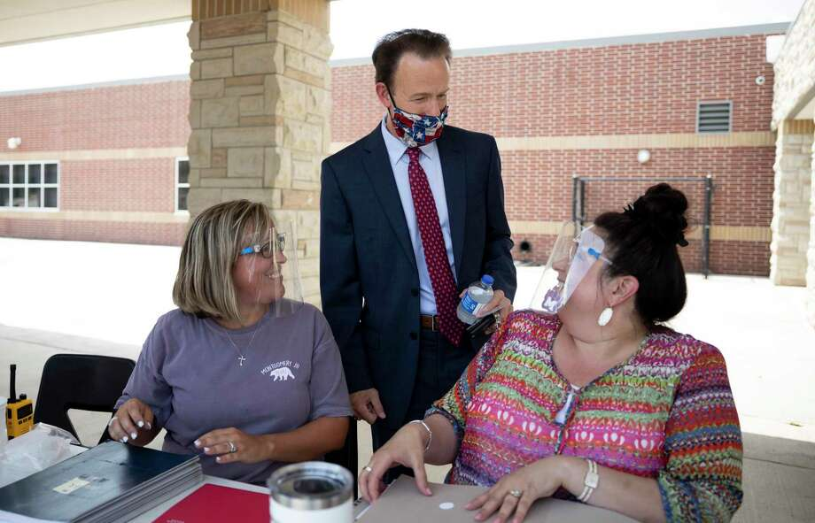 Heath Morrison, the new superintendent of Montgomery ISD, speaks with Amy Stanley, left and Barbara Gagliano, right, at Montgomery Junior High School in August. The district's board of trustees voted for a 2 percent mid-year raise — effective Nov. 1. Photo: Gustavo Huerta, Houston Chronicle / Staff Photographer / Houston Chronicle © 2020