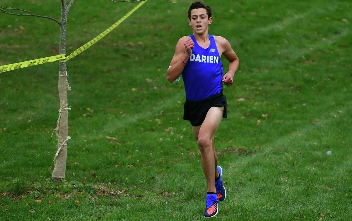 Lucas Madariaga of Darien High School and the boys cross country team takes on Greenwich Tuesday, October 27, 2020, at Tod's Point in Greenwich, Conn.