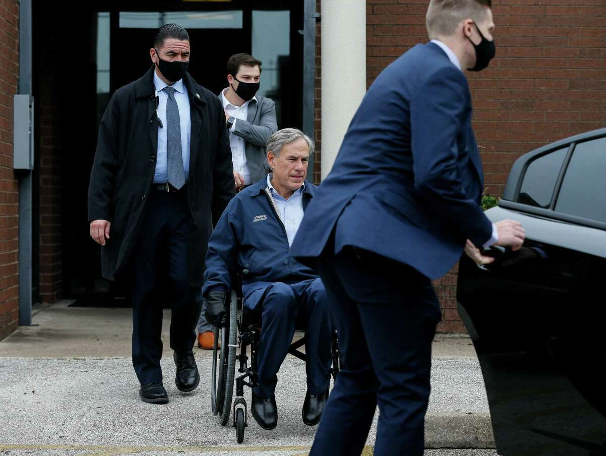 Gov. Greg Abbott departs the Houston Police Officer's Union Headquarters, following a