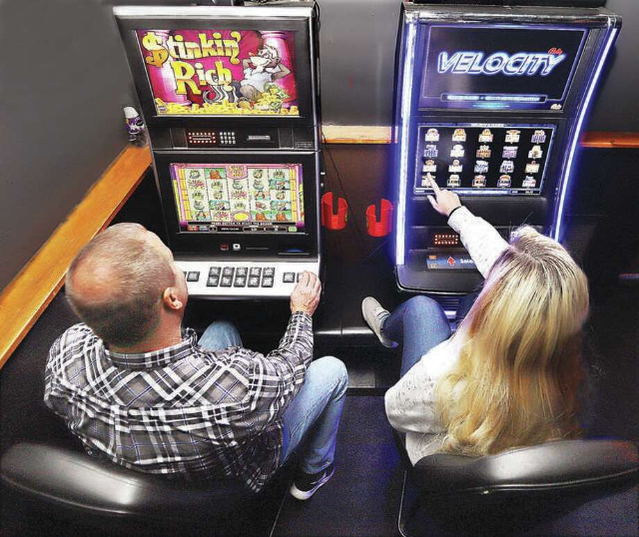 Two gamblers try their luck on the slot machines inside Bubby and Sissy's bar on Belle Street in Alton. The Glen Carbon Board of Trustees voted to pass an ordinance to allow video gaming Tuesday, allowing video gaming systems similar to these in specific establishments. Photo: John Badman File Photo