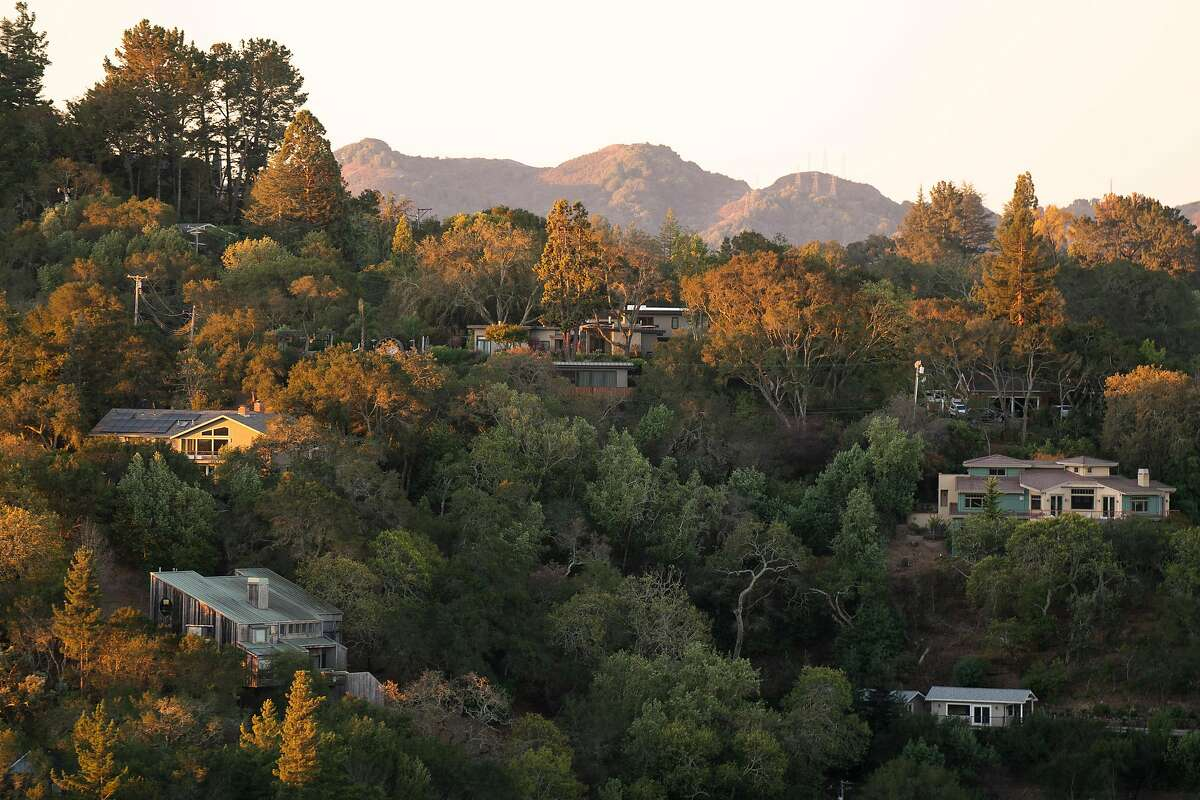 The sun rises on homes without power during the PG&E shut-off in Orinda Tuesday. PG&E said power had been restored by midday Wednesday for almost all of its 345,000 customers affected by power shut-offs that began Sunday.