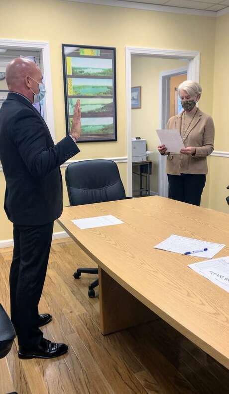 First Selectman Pat Del Monaco swears in Cassavechia as the newest member of New Fairfield's police force the morning of Monday, Oct. 26, 2020. Photo: Contributed Photo