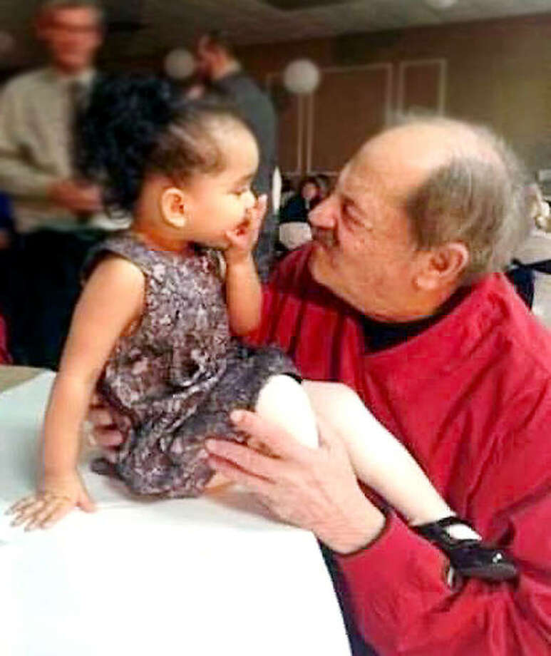 Charlie Nasello and his granddaughter Kinsley make faces during a family get-together. Nasello, a longtime booster and a founding father of soccer in the area, died Tuesday at the age of 81. Photo: Nasello Family Photo
