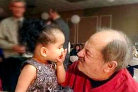 Charlie Nasello and his granddaughter Kinsley make faces during a family get-together. Nasello, a longtime booster and a founding father of soccer in the area, died Tuesday at the age of 81.