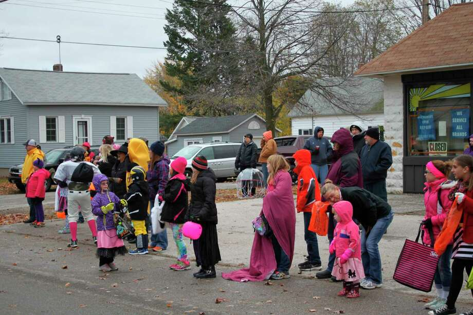 "In 2014, as in many past years, children lined the streets in Filer Township for the annual Halloween parade. The event has been canceled this year.  Filer Township Fire Department Chief Jim Espvik said ""We are very thankful to everyone for all the support we have had to sponsor this event over the past many years and look to continue many more years in the future."" (File photo)"