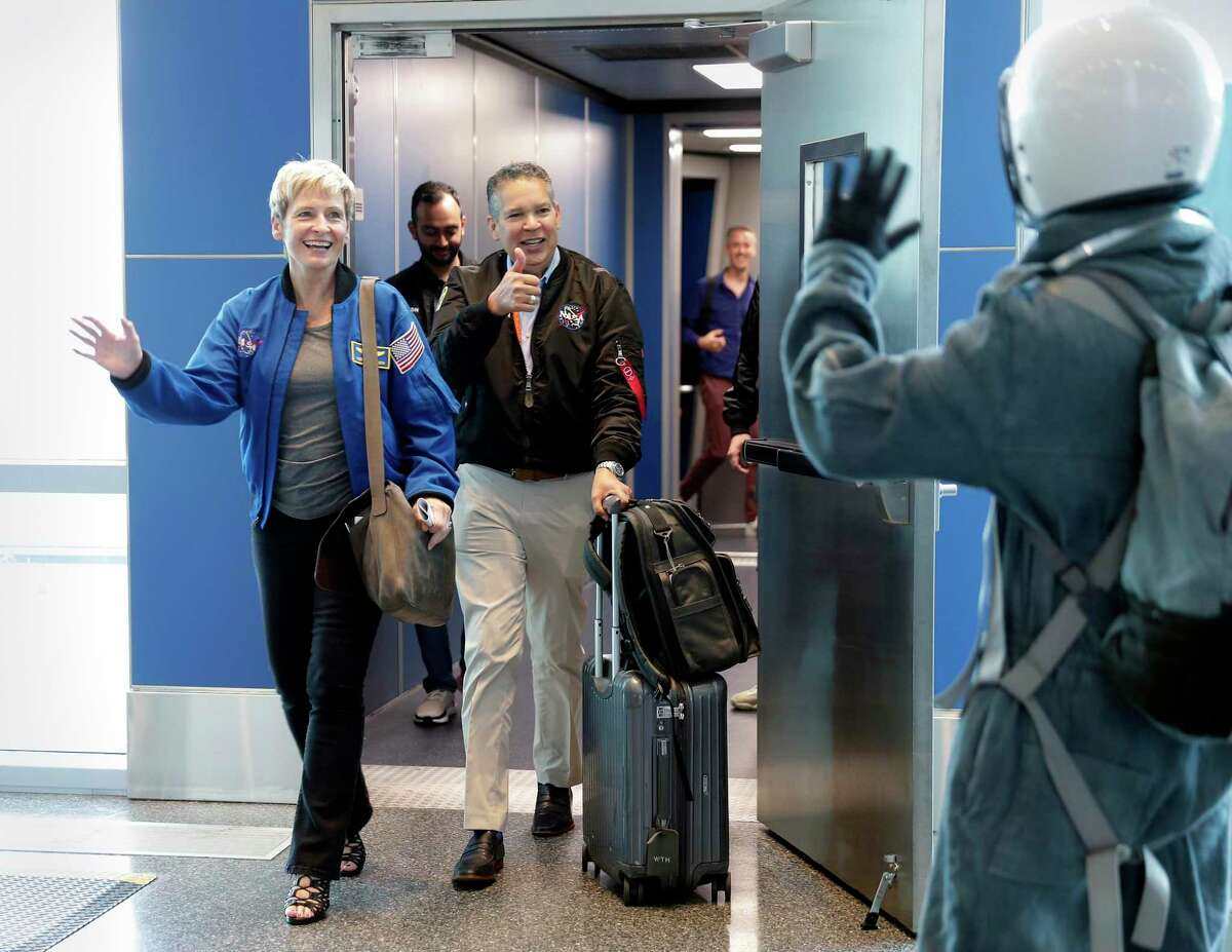 Peggy Whitson, Retired NASA Astronaut and former NASA Chief Astronaut, left, and William Harris, CEO, Space Center Houston, center, are greeted as they arrive from a United flight before a ceremony commemorating the 50th anniversary of the Apollo 11 moon landing hosted by Houston First Space Center and United Airlines held in Terminal C at the Bush Intercontinental Airport Wednesday, July. 17, 2019 in Houston, TX.