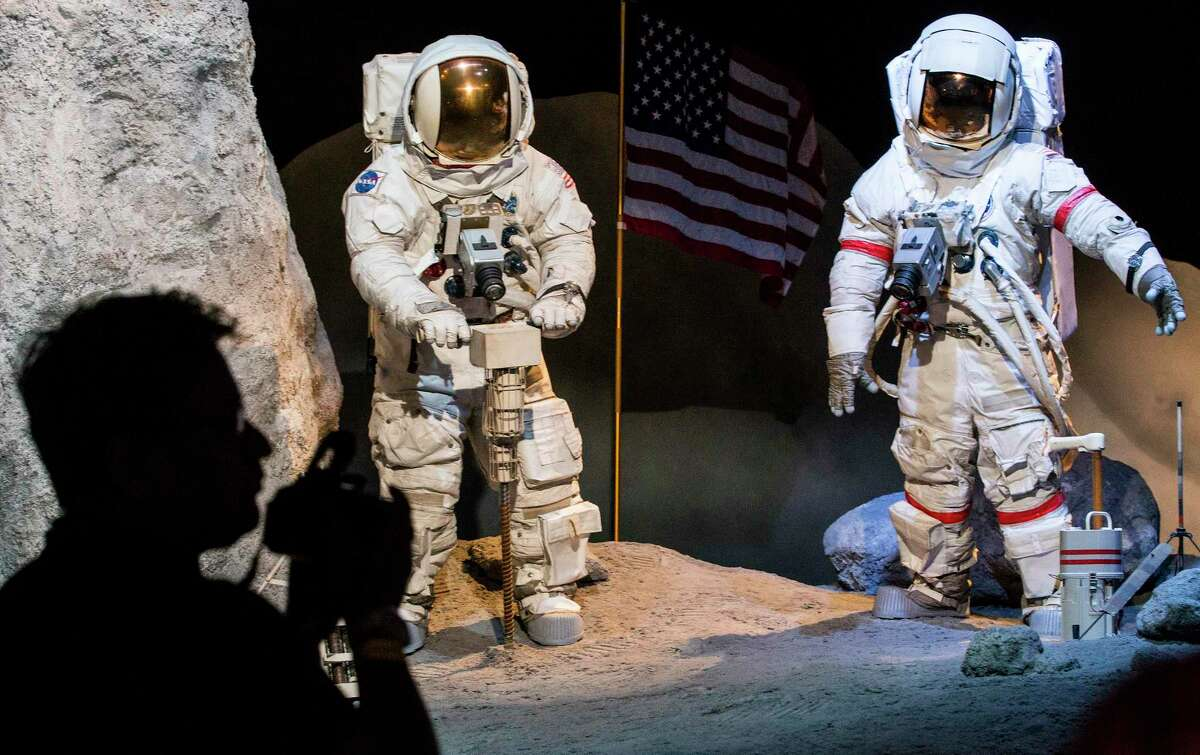 Apollo space suits are part of a diorama of the moon landings during the 50th anniversary celebration of the Apollo 11 moon landing at Space Center Houston on Saturday, July 20, 2019, in Houston.