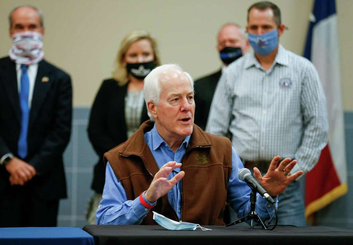 Sen. John Cornyn talks to reporters during a press conference inside the Houston Police Officer's Union Headquarters, where he signed a