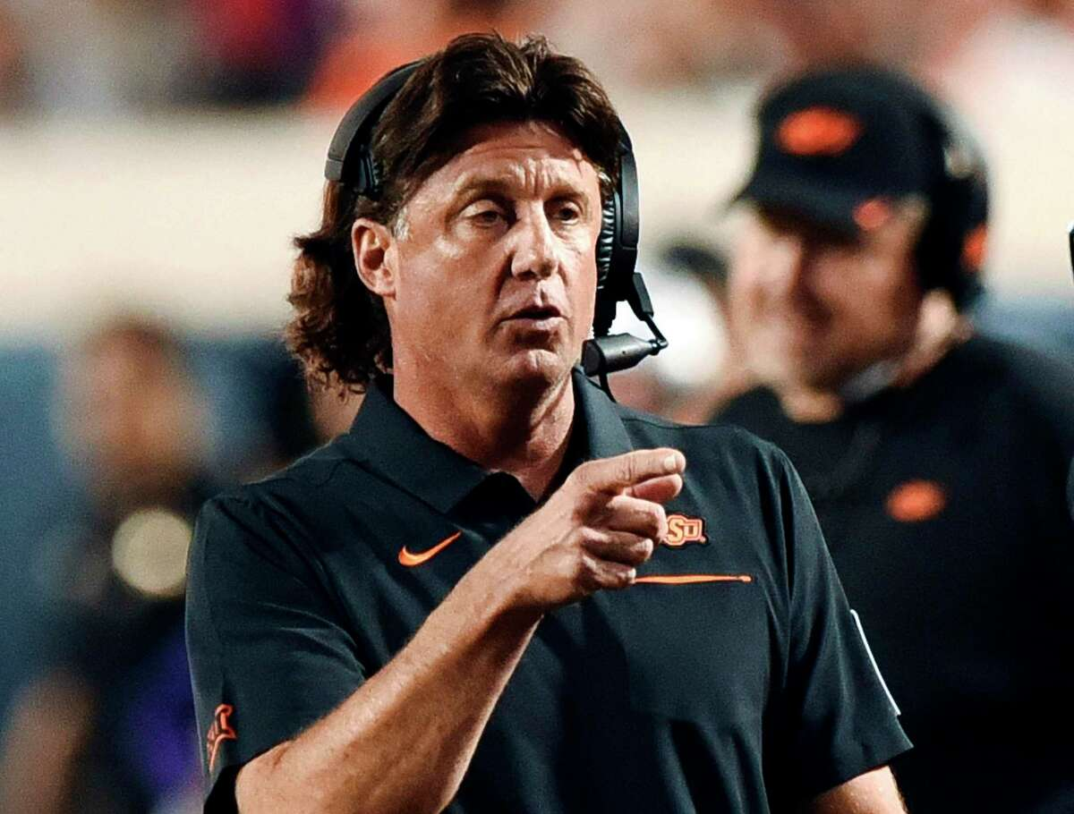 Mike Gundy's Oklahoma State Cowboys take a 4-0 record and No. 6 ranking into Saturday's home game against Texas, whose offensive coordinator, Mike Yurcich, held the same role under Gundy from 2013-18.