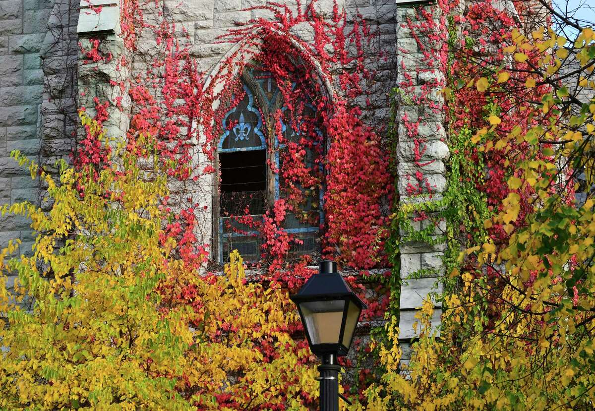 Colorful foliage covers the exterior of an abandon church on Wednesday, Oct. 28, 2020 in Albany, N.Y. (Lori Van Buren/Times Union)