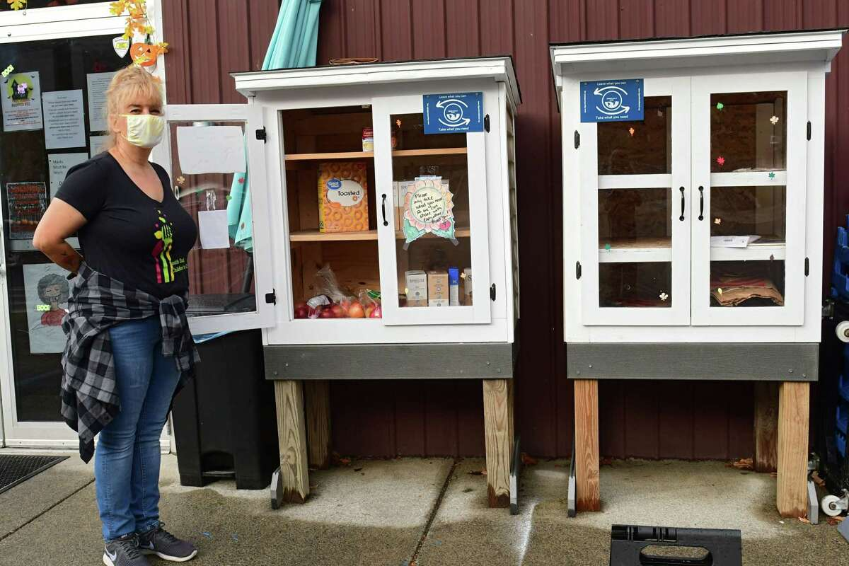 Tracie Killar, director of the South End Children's Cafe, stands next to the free food pantries outside the South End Children's Cafe on Wednesday, Oct. 28, 2020 in Albany, N.Y. (Lori Van Buren/Times Union)