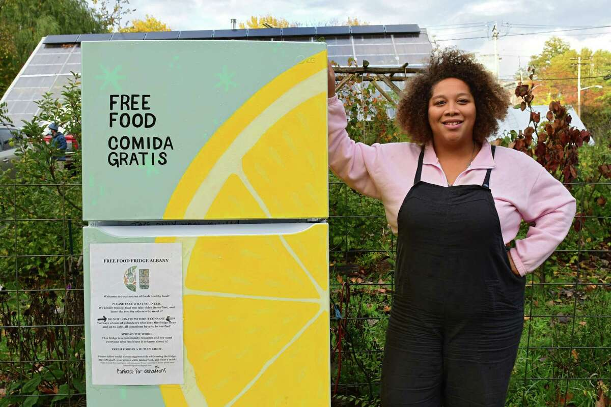 Jammella Anderson, founder of Free Food Fridge Albany, stands next one of the Free Food Fridges on Wednesday, Oct. 28, 2020 in Albany, N.Y. She will be featured in a special Time magazine issue on women and the pandemic in March 2021. (Lori Van Buren/Times Union)