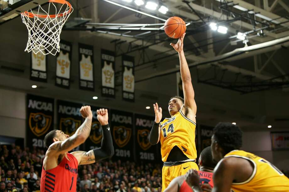 RICHMOND, VA - FEBRUARY 18: Marcus Santos-Silva #14 of the VCU Rams shoots over Obi Toppin #1 of the Dayton Flyers in the second half during a game at Stuart C. Siegel Center on February 18, 2020 in Richmond, Virginia. (Photo by Ryan M. Kelly/Getty Images) Photo: Ryan M. Kelly/Getty Images / 2020 Getty Images