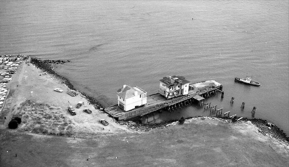 July 3, 1962: A Pacific Heights mansion is loaded on a barge for a trip across the Bay to its new home in Belvedere. The home at 1818 Broadway in San Francisco was replaced with apartments. Photo: Duke Downey / The Chronicle