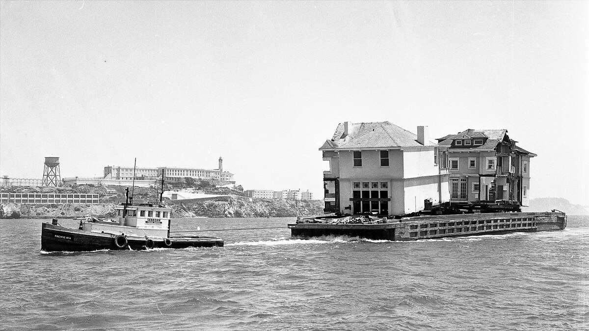 A Pacific Heights mansion crosses the San Francisco Bay on July 3, 1962, to its new home in Belvedere. The Moffitt Mansion was chainsawed in half and placed on a barge.