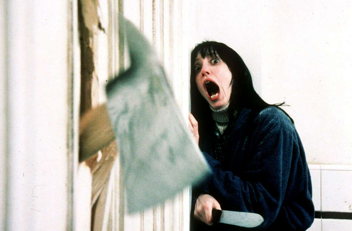"""FILE--Actress Shelly Duvall, portraying """"Wendy Torrance,"""" screams as an axe rips through a bathroom door in the movie """"The Shining"""" directed by Stanley Kubrick. (AP Photo/Warner Bros. Inc.)"""