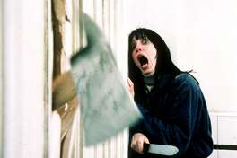 "FILE--Actress Shelly Duvall, portraying ""Wendy Torrance,"" screams as an axe rips through a bathroom door in the movie ""The Shining"" directed by Stanley Kubrick. (AP Photo/Warner Bros. Inc.)"