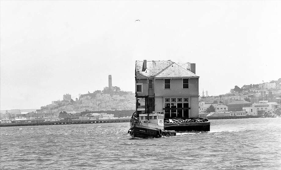 July 3, 1962: The Moffitt Mansion in Pacific Heights, top, was chain-sawed in half and placed on a barge. It crossed the San Francisco Bay to its new home in Belvedere, above, where it sits today. Photo: Gordon Peters / The Chronicle