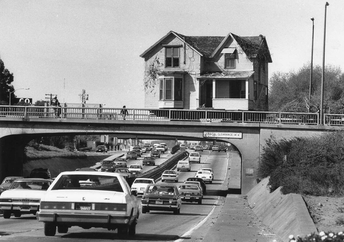 Two homes are moved from downtown San Jose to the San Jose Historical Museum on Feb. 2, 1987. They had to use overpasses because they were too tall to fit under Interstate 680.