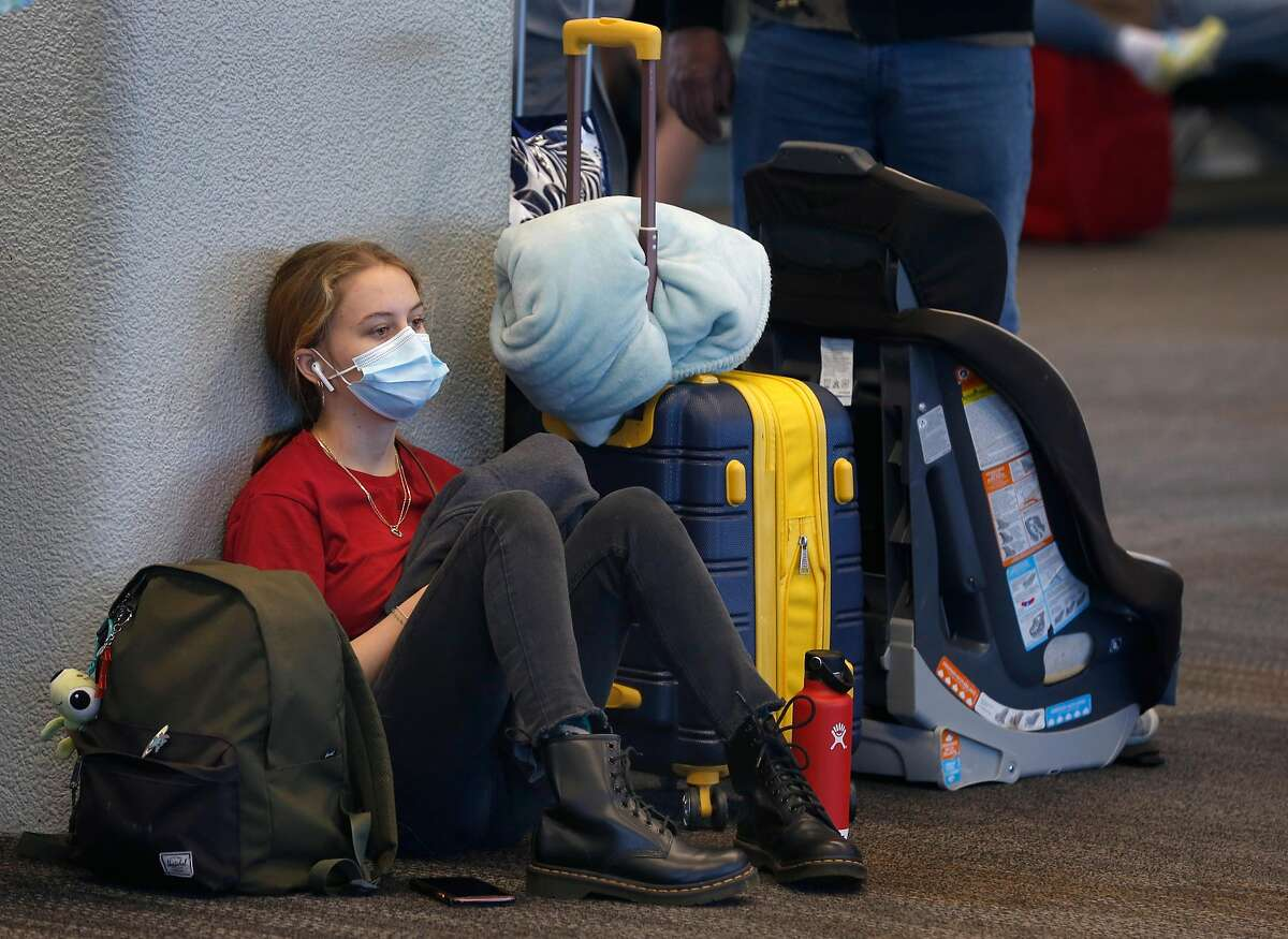 Pamela Larson, 16, waits to board a flight home to Honolulu at SFO in San Francisco, Calif. on Thursday, Oct. 15, 2020. As the airline industry sees a modest rise in travel, a rapid COVID-19 testing site has been set up at the airport to provide travelers with documentation of test results to present upon arrival at their final destinations.