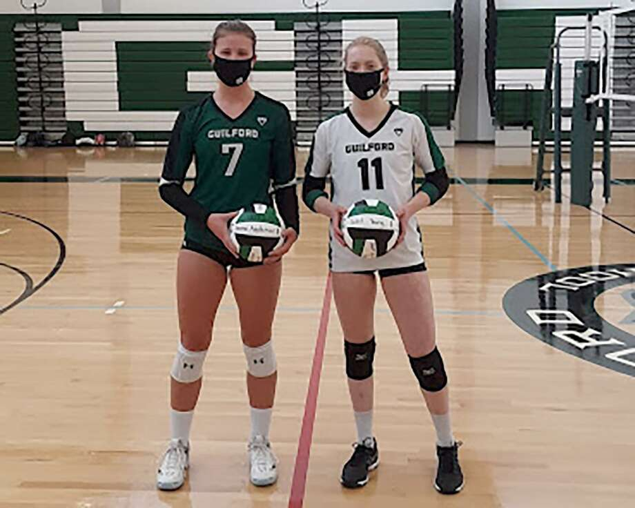 Emma Appleman, left, and Juliet Young recently hit career milestones for the Guilford volleyball program. Photo: Contributed Photo / Hearst Connecticut Media