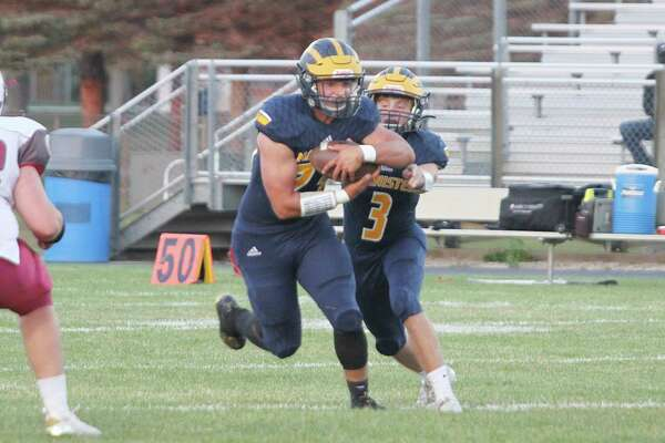 Manistee running back Landen Powers takes a handoff from quarterback Jeff Huber earlier this season. The Chippewas will open the playoffs at 7 p.m. on Friday against Kalkaska at Chippewa Field. (News Advocate file photo)
