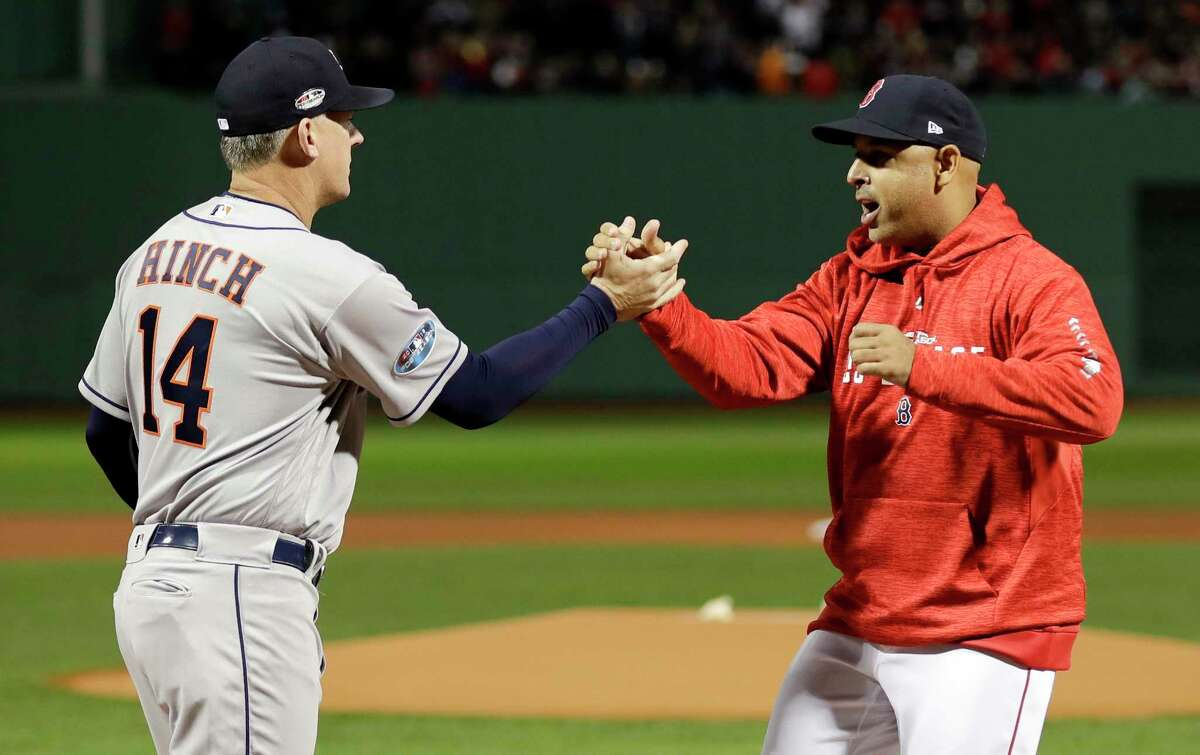 Former Astros manager A.J. Hinch, left, and former Red Sox manager Alex Cora, formerly a coach under Hinch, have been mentioned as candidates to fill vacancies with the White Sox and Tigers.