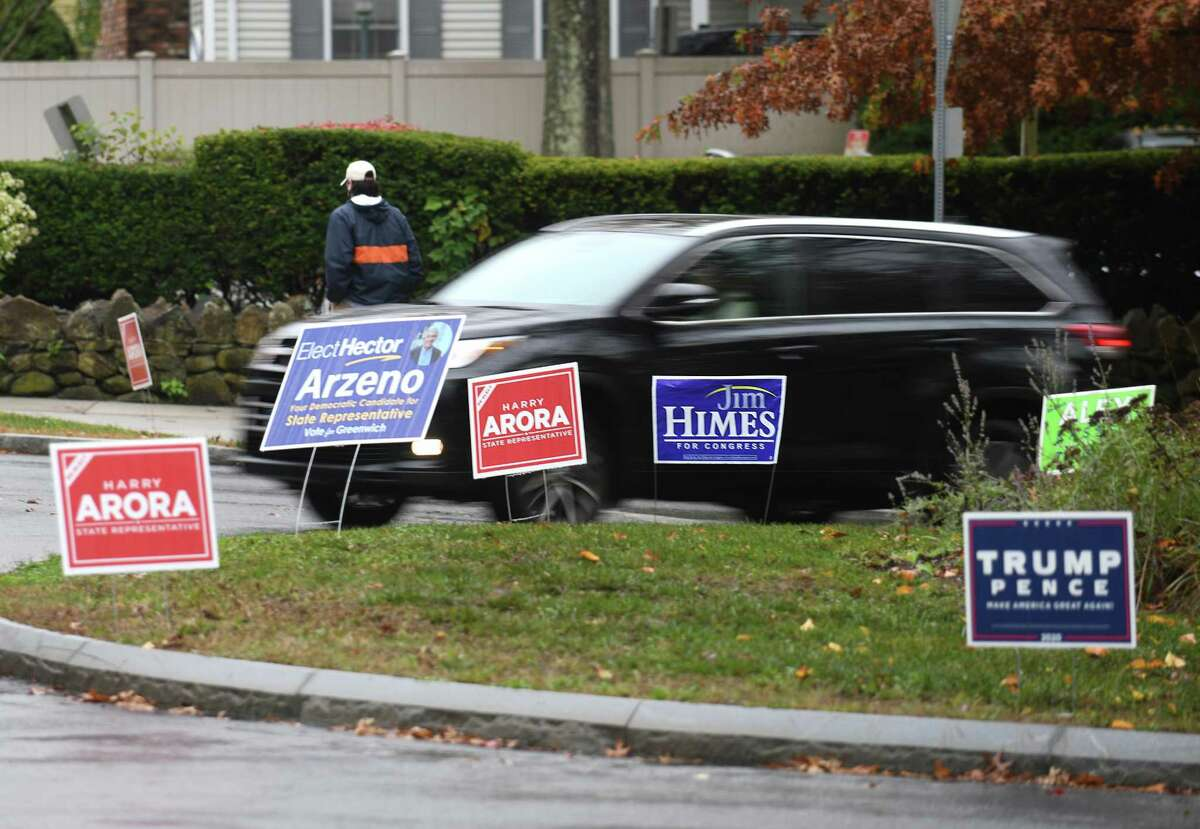Signs for local, state, and national political candidates are displayed in the roundabout by Greenwich Hospital in Greenwich, Conn. Wednesday, Oct. 28, 2020.