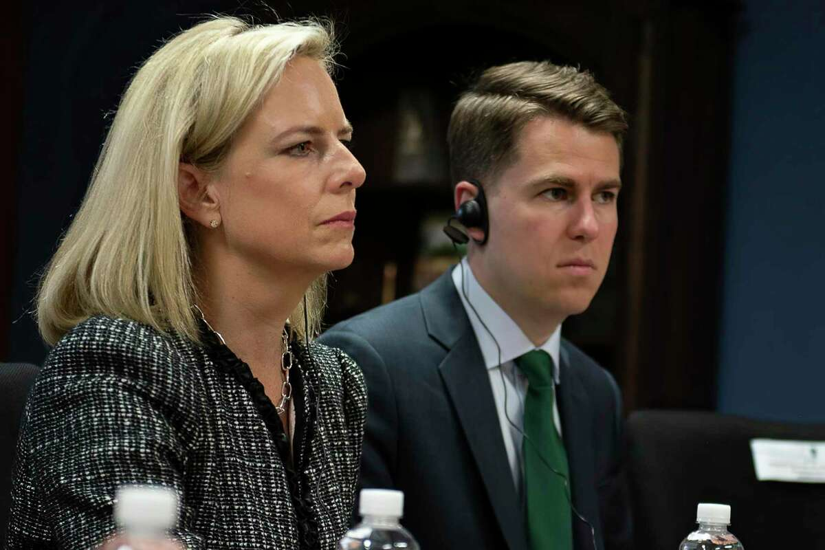 This March 27, 2018, provided by the Department of Homeland Security, then-Secretary of Homeland Security Kirstjen Nielsen and then-Department of Homeland Security chief of staff Miles Taylor, right, meet with Honduran President Juan Hernandez, not pictured, and security ministers from the Northern Triangle countries in Tegucigalpa, Honduras. Taylor, a former Trump administration official who penned a scathing anti-Trump op-ed and book under the pen name