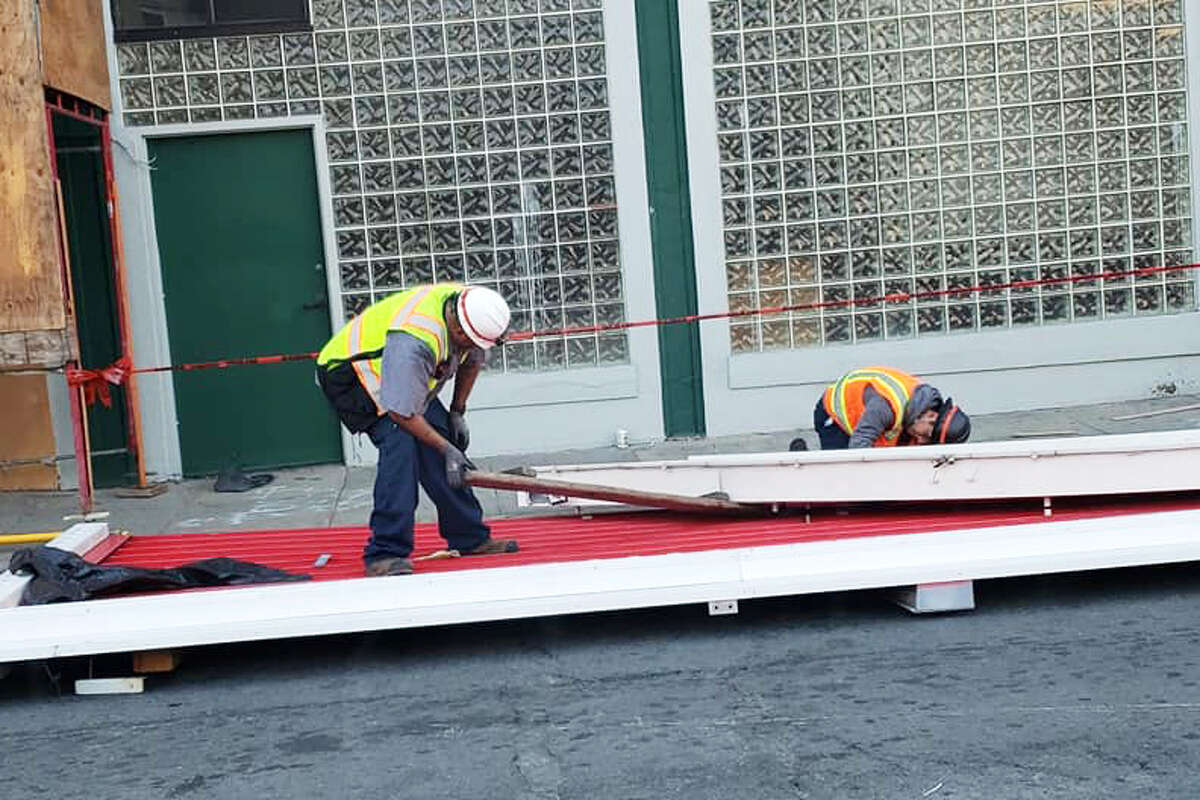Workers disassemble San Francisco's iconic Coca-Cola billboard in a photo posted Oct. 28, 2020.