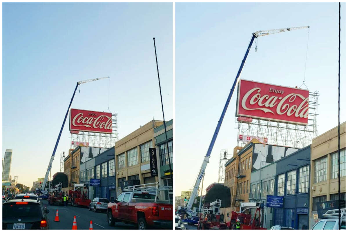 A crew takes down San Francisco's iconic Coca-Cola billboard in these photos posted Oct. 28, 2020.