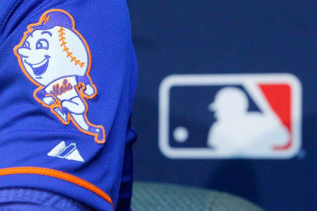 The New York Mets logo is seen on the sleeve of Matt Harvey as he addresses the media the day before Game 1 of the 2015 World Series between the Royals and Mets at Kauffman Stadium on October 26, 2015, in Kansas City, Missouri. (Kyle Rivas/Getty Images/TNS) Photo: Kyle Rivas, TNS