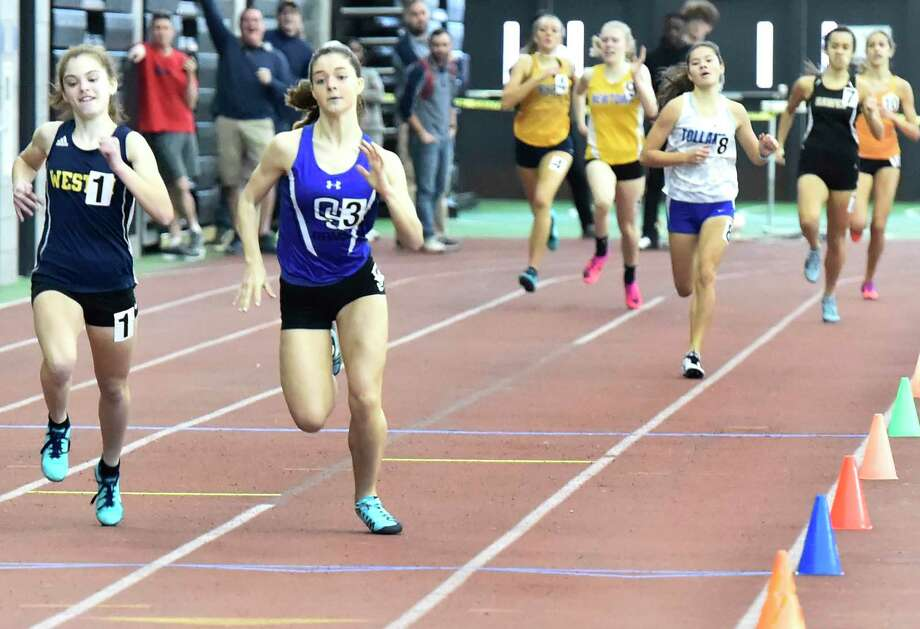 New Haven Connecticut - February 22, 2020: Julia Rosenberg of Weston H.S., left, races second-place finisher Grace Hanratty of Old Saybrook H.S. to the finish line winning the 1000-meter run during the CIAC State Open Indoor Track Championship Saturday at the Floyd Little Athletic Center in New Haven. Photo: Peter Hvizdak / Hearst Connecticut Media / New Haven Register