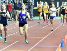 New Haven Connecticut - February 22, 2020: Julia Rosenberg of Weston H.S., left, races second-place finisher Grace Hanratty of Old Saybrook H.S. to the finish line winning the 1000-meter run during the CIAC State Open Indoor Track Championship Saturday at the Floyd Little Athletic Center in New Haven.