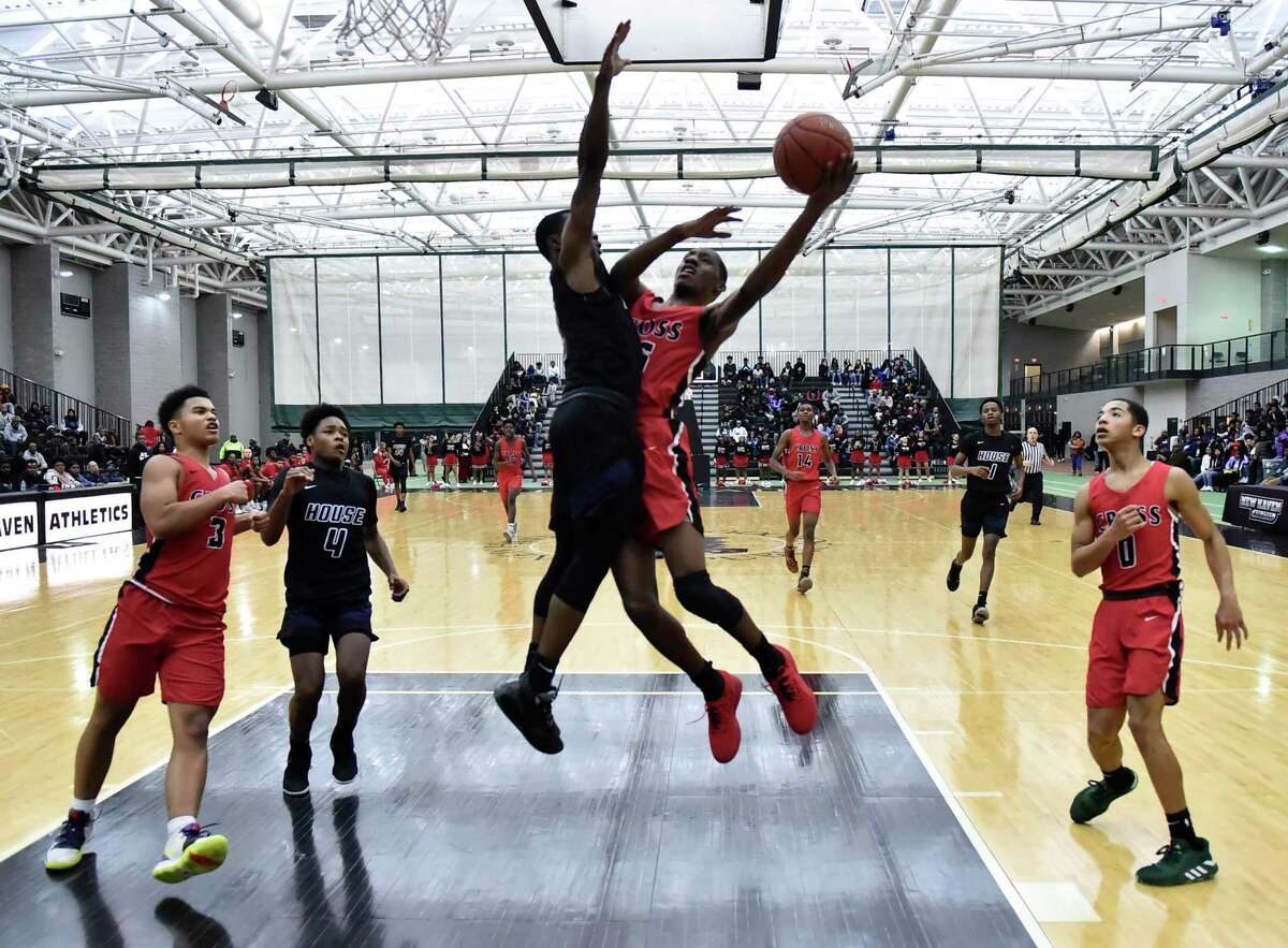 New Haven, Connecticut - January 30, 2020: Hillhouse H.S. vs. Wilbur Cross H.S. second quarter boys basketball Thursday evening at the Floyd Little Athletic Center in New Haven.