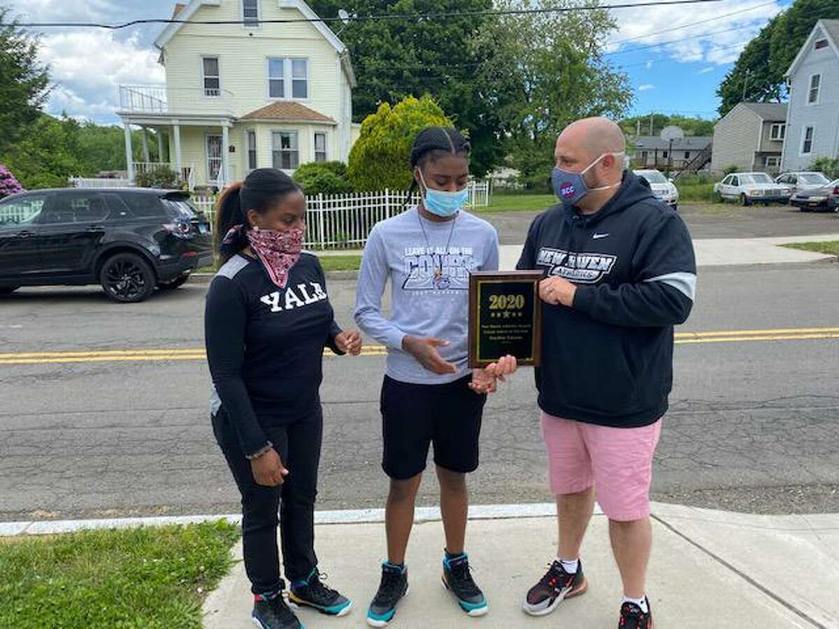 New Haven Public Schools athletic director Erik Patchkofsky hands out the city's Female Athlete of the Year to Hillhouse's Keyshan Johnson, center, on June 1. At left is Keyshan's mother, Tomeka. Patchkofsky, who is also the director of the Floyd Little Athletic Center, said: