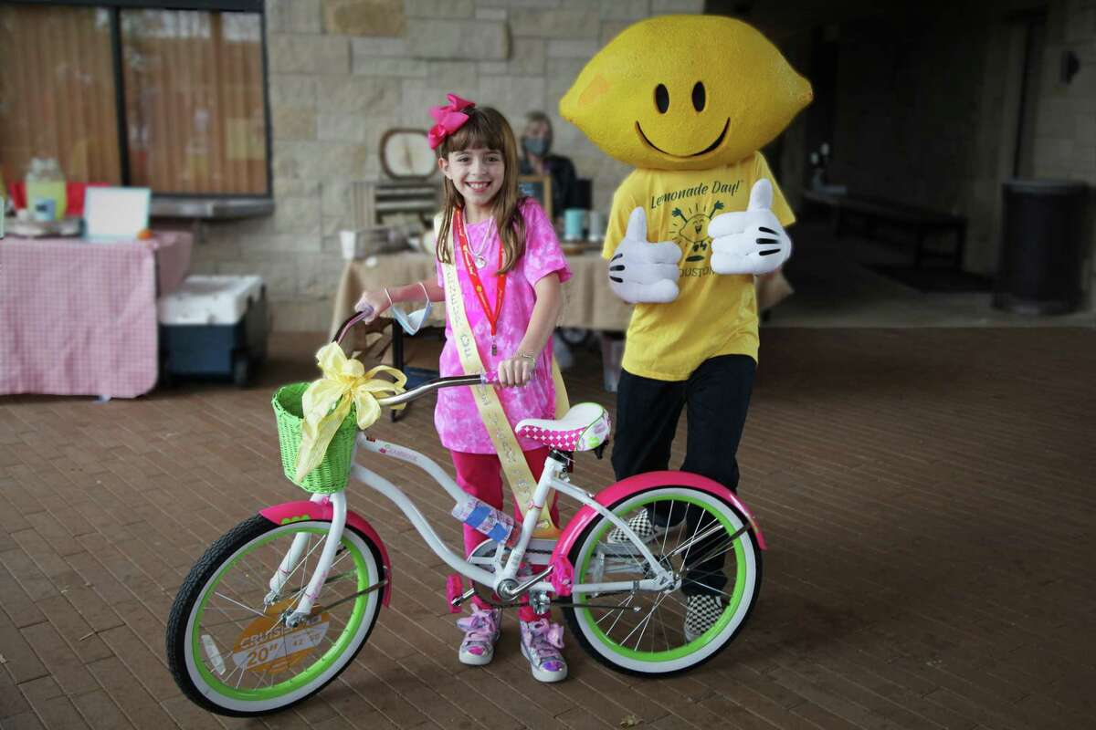 Recognized as the Lemonade Day Houston 2020 Youth Entrepreneur of the Year, 9-year-old Sugar Land resident Sabrina Roesler receives a free bicycle.